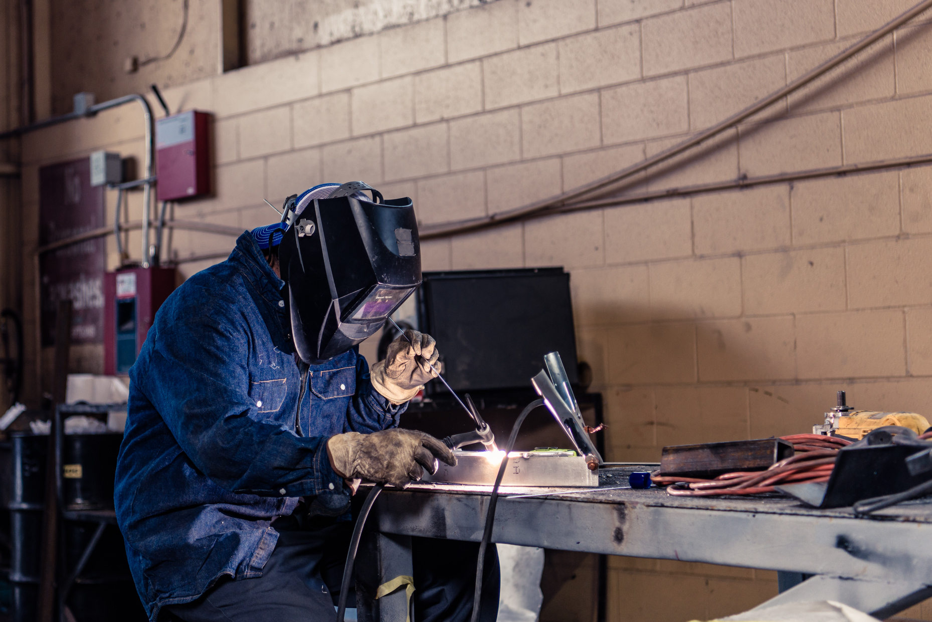 Austin-Industrial-Photographers-Texas-Trocas-Welding-Workshop-mask-gloves-worker